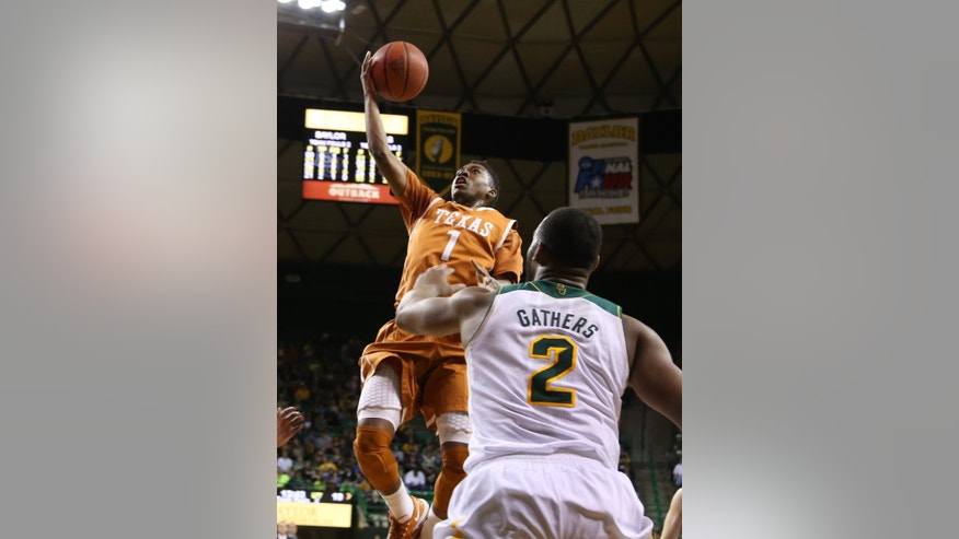 Texas guard Isaiah Taylor (1) shoots over Baylor forward Rico Gathers (2) in the first half of a NCAA college basketball game, Saturday, Jan. 25, 2014, in Waco, Texas. (AP Photo/Waco Tribune Herald, Rod Aydelotte)