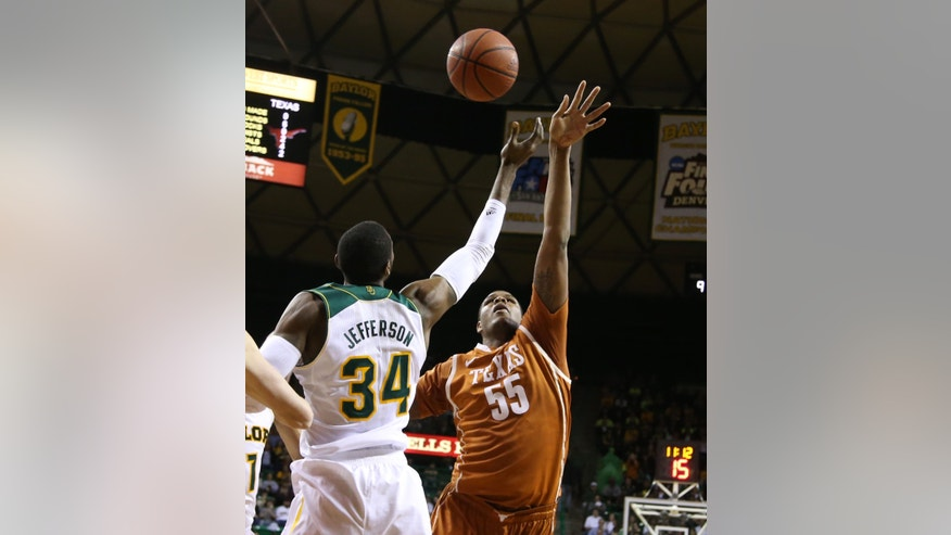 Texas center Cameron Ridley (55) reaches for a rebound with Baylor forward Cory Jefferson (34) in the first half of a NCAA college basketball game, Saturday, Jan. 25, 2014, in Waco, Texas. (AP Photo/Waco Tribune Herald, Rod Aydelotte)