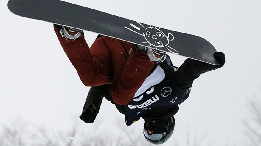 Jan. 20, 2013: Switzerland's Iouri Podladtchikov flies in the air during the men's Snowboard Halfpipe finals at the FIS Snowboard World Championships in Stoneham, Quebec. Podladtchikov won the competition.