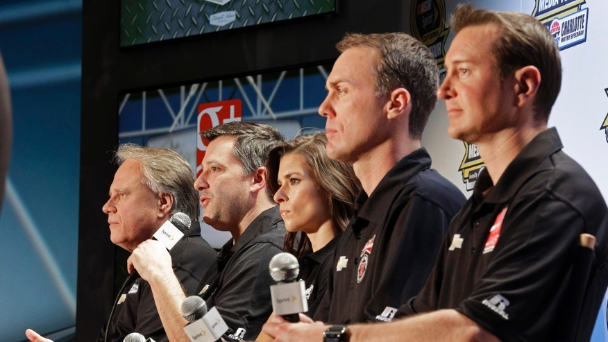 Driver/owner Tony Stewart, second from left, speaks as co-owner Gene Haas, left, and drivers, from right, Kurt Busch, Kevin Harvick and Danica Patrick listen during a news conference at the NASCAR Sprint Cup auto racing Media Tour in Charlotte, N.C., Monday, Jan. 27, 2014. (AP Photo/Chuck Burton)