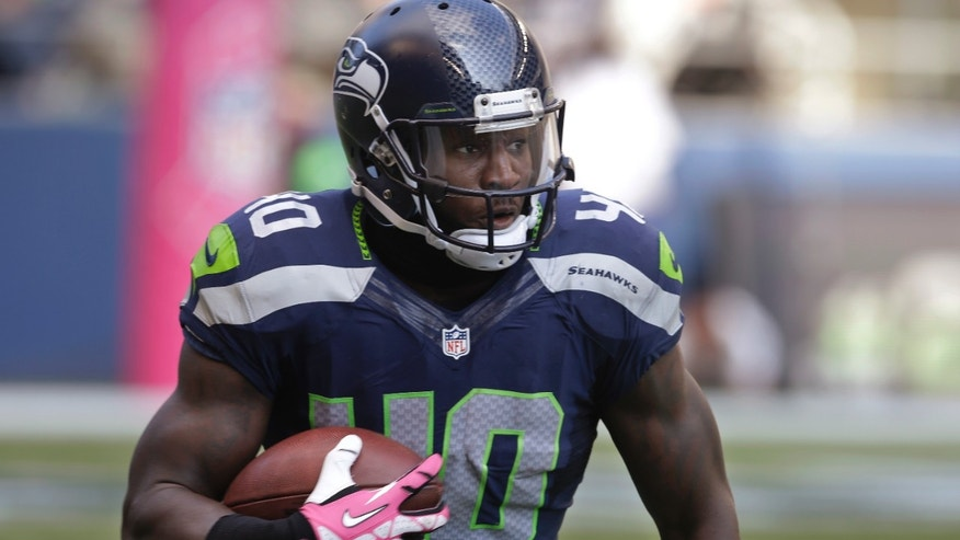 In this Oct. 13, 2013, photo, Seattle Seahawks' Derrick Coleman carries the ball against the Tennessee Titans during an NFL football game in Seattle. Coleman never listened to all those people telling him what he couldn't do. He couldn't hear them, anyway, on his way to becoming first deaf offensive player in the NFL. (AP Photo/Elaine Thompson)