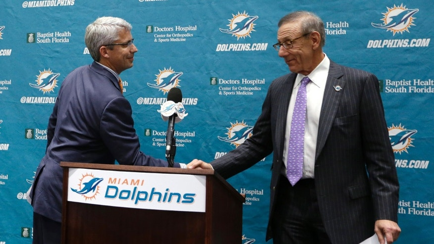 Dennis Hickey, left, the new general manager for the Miami Dolphins NFL football team, shakes hands with team owner Stephen Ross during a news conference Tuesday, Jan. 28, 2014, in Davie, Fla. (AP Photo/Lynne Sladky)