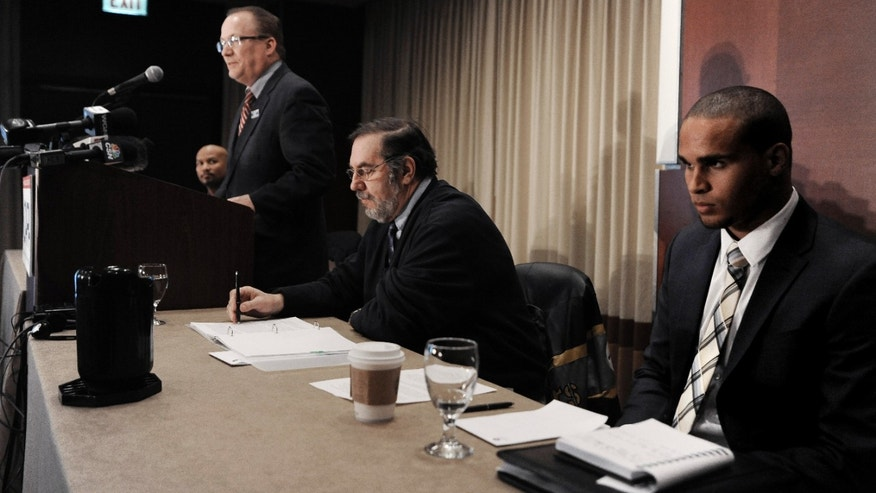 "CORRECTS SPELLING TO COLTER, INSTEAD OF COULTER - Northwestern quarterback Kain Colter right, and United Steelworkers union President Leo Gerard center, listen on as Steelworkers official Tim Waters speaks during a news conference in Chicago, Tuesday, Jan., 28, 2014. Calling the NCAA a ""dictatorship,"" a handful of Northwestern football players announced Tuesday they are forming the first labor union for college athletes--one they hope will eventually represent players nationwide. (AP Photo/Paul Beaty)"