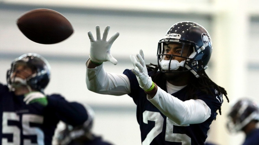 Seattle Seahawks cornerback Richard Sherman catches a ball during NFL football practice Wednesday, Jan. 29, 2014, in East Rutherford, N.J. The Seahawks and the Denver Broncos are scheduled to play in the Super Bowl XLVIII football game Sunday, Feb. 2, 2014. (AP Photo/Jeff Roberson)