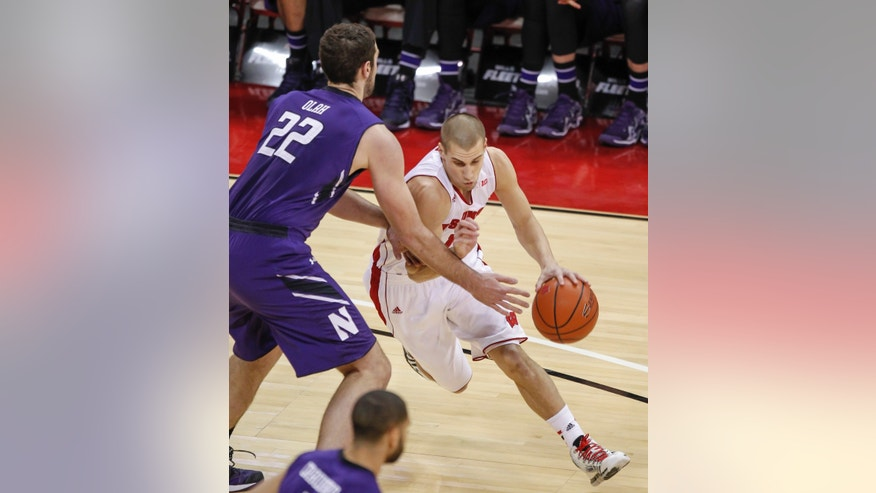Wisconsin's Ben Brust, right, drives against Northwestern's Alex Olah during the first half of an NCAA college basketball game Wednesday, Jan. 29, 2014, in Madison, Wis. (AP Photo/Andy Manis)