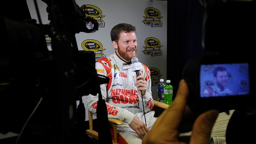 Dale Earnhardt Jr. smiles as he responds to a question during a breakout session at the NASCAR Sprint Cup Series media tour Tuesday, Jan. 28, 2014, in Charlotte, N.C. (AP Photo/The Charlotte Observer, Jeff Siner) MAGS OUT  TV OUT  ONLINES OUT