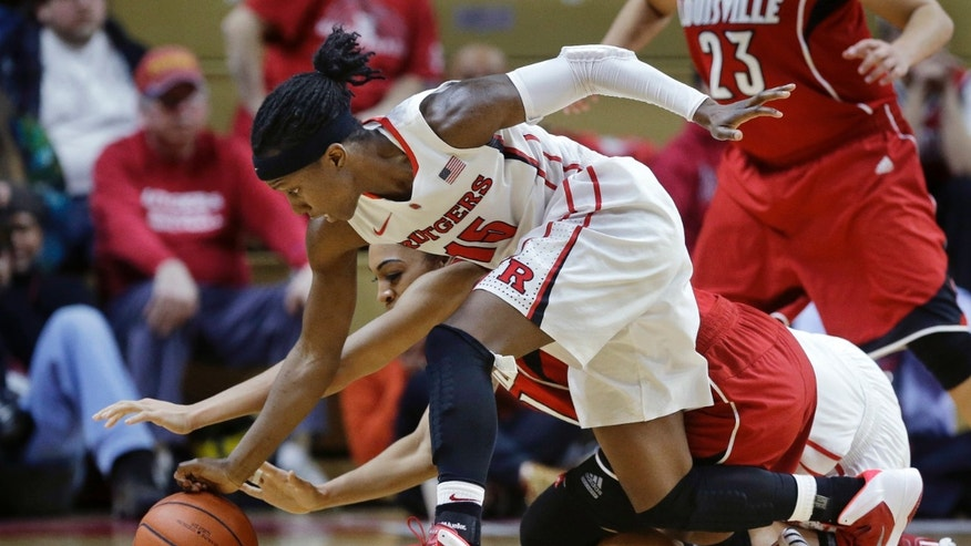 Rutgers guard Syessence Davis (15) grabs for the ball during the second half of an NCAA college basketball game against Louisville on Tuesday, Jan. 28, 2014, in Piscataway, N.J. Louisville won 80-71. (AP Photo/Mel Evans)