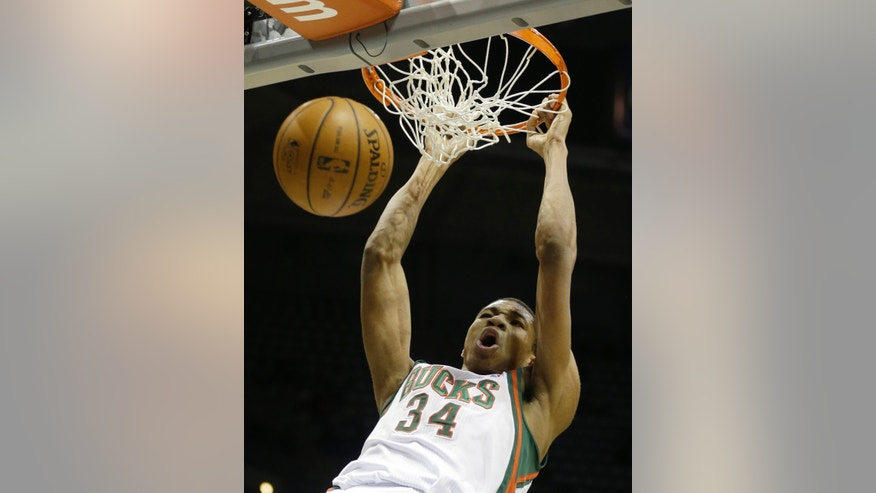 Milwaukee Bucks' Giannis Antetokounmpo dunks against the Phoenix Suns during the second half of an NBA basketball game Wednesday, Jan. 29, 2014, in Milwaukee. (AP Photo/Jeffrey Phelps)