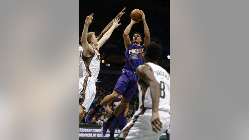Phoenix Suns' Gerald Green (14) puts up a shot against the Milwaukee Bucks during the first half of an NBA basketball game Wednesday, Jan. 29, 2014, in Milwaukee. (AP Photo/Jeffrey Phelps)