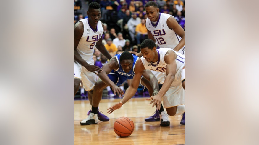 LSU forward Jordan Mickey, right, and Kentucky forward Julius Randle (30) dive for a loose ball during the first half of an NCAA college basketball game in Baton Rouge, La., Tuesday, Jan. 28, 2014. (AP Photo/Tim Mueller)
