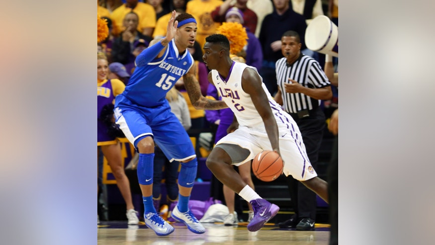 LSU forward Johnny O'Bryant III (2) drives against Kentucky forward Willie Cauley-Stein (15) during the first half of an NCAA college basketball game in Baton Rouge, La., Tuesday, Jan. 28, 2014. (AP Photo/Tim Mueller)