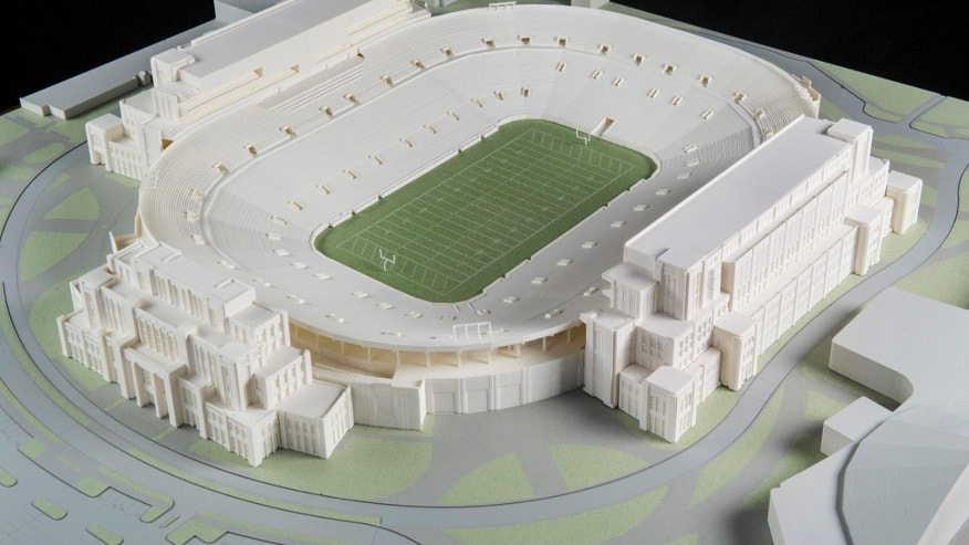 "In this Jan. 17, 2014 photo is a model of The University of Notre Dame's new football stadium. Notre Dame announced plans Wednesday, Jan. 29, 2014 to expand the school's 84-year-old football stadium, adding up to 4,000 premium seats and spending about $400 million to add buildings on three sides of the ""House that Rockne Built."" (AP Photo/The University of Notre Dame, Barbara Johnston)"