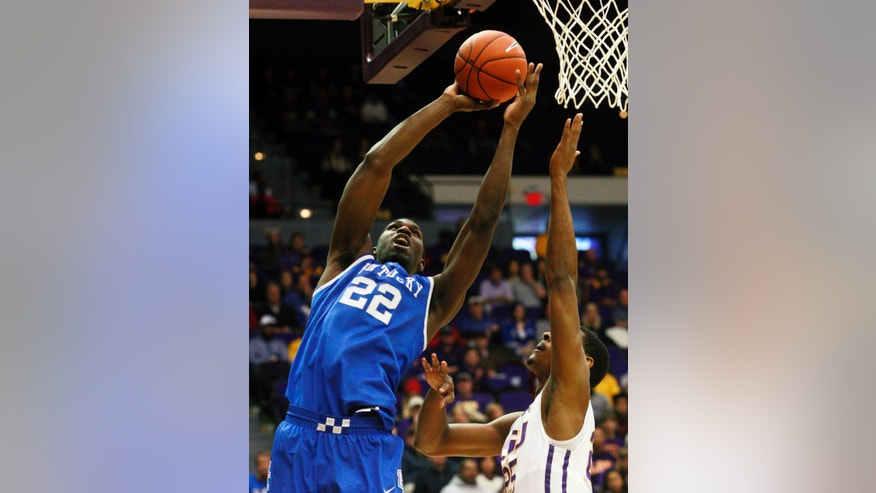 Kentucky forward Alex Poythress (22) drives to the basket against LSU during the first half of an NCAA college basketball game in Baton Rouge, La., Tuesday, Jan. 28, 2014. (AP Photo/Tim Mueller)