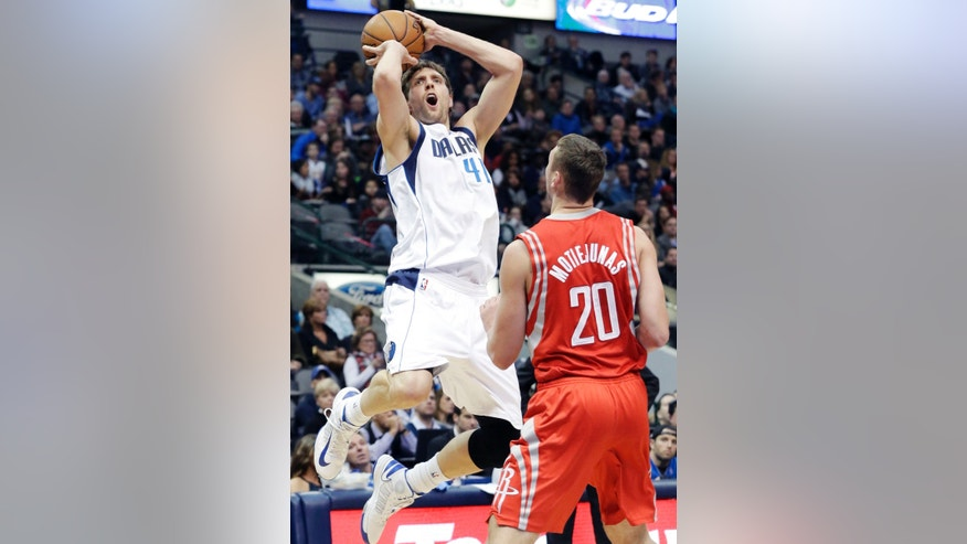 Dallas Mavericks forward Dirk Nowitzki (41), of Germany, shoots against Houston Rockets forward Donatas Motiejunas (20), of Lithuanian, during the first half of an NBA basketball game Wednesday, Jan. 29, 2014, in Dallas. (AP Photo/LM Otero)