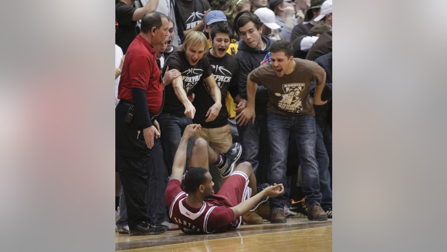 Fans heckle Massachusetts guard Clyde Santee after he tumbled to the court during the first half of an NCAA college basketball game against St. Bonaventure in St. Bonaventure, N.Y.  Wednesday, Jan 29, 2014. (AP Photo/Nick LoVerde)