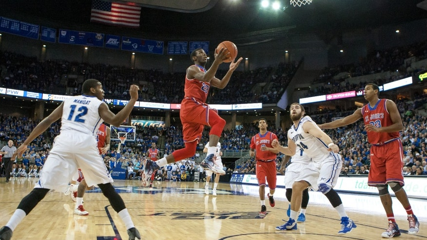 St. John's guard Rysheed Jordan (23) goes for a layup during the first half of an NCAA college basketball game against Creighton in Omaha, Neb., Tuesday, Jan. 28, 2014. (AP Photo/John Peterson)