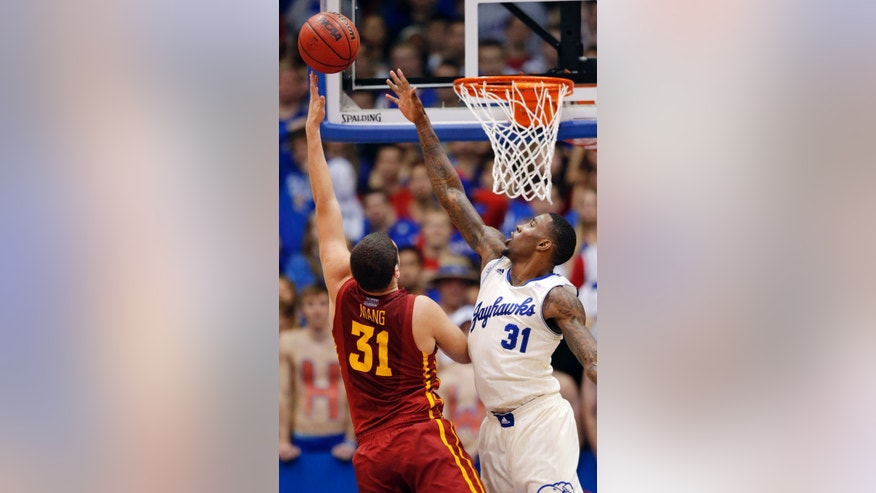 Iowa State forward Georges Niang, left, shoots over Kansas forward Jamari Traylor during the first half of an NCAA college basketball game in Lawrence, Kan., Wednesday, Jan. 29, 2014. (AP Photo/Orlin Wagner)