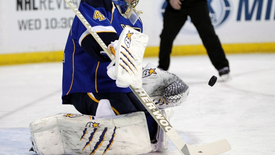 St. Louis Blues goalie Jaroslav Halak (41) makes a save in the first period against the New Jersey Devils of an NHL hockey game, Tuesday, Jan. 28, 2014 in St. Louis. (AP Photo/Tom Gannam)