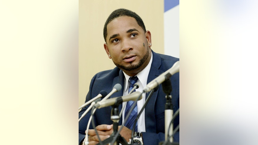 Yakult Swallows slugger Wladimir Balentien speaks during a press conference in Tokyo Wednesday, Jan. 29, 2014. Balentien has apologized to his fans, several days after pleading not guilty to domestic violence charges in Florida. As is the custom in Japan, Balentien bowed deeply and then apologized Wednesday to his fans and teammates for the actions that led to his arrest on Jan. 13. (AP Photo/Kyodo News) JAPAN OUT, MANDATORY CREDIT