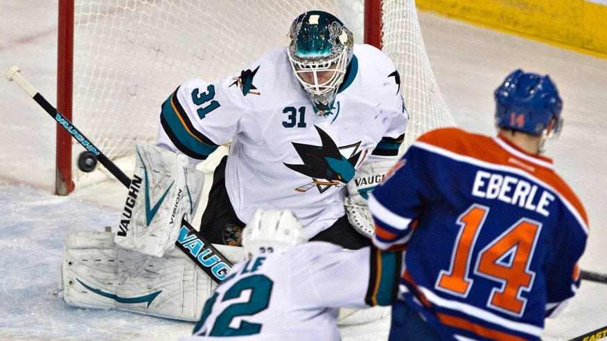 San Jose Sharks goalie Antti Niemi (31) makes the save on Edmonton Oilers Jordan Eberle (14) as Dan Boyle (22) defends during the second period of an NHL hockey game Wednesday, Jan. 29, 2014, in Edmonton, Alberta. (AP Photo/The Canadian Press, Jason Franson)