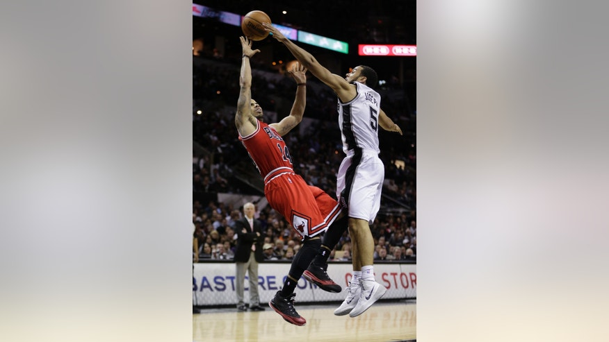 Chicago Bulls' D.J. Augustin (14) is fouled by San Antonio Spurs' Cory Joseph (5) during the second half of an NBA basketball game, Wednesday, Jan. 29, 2014, in San Antonio. (AP Photo/Eric Gay)