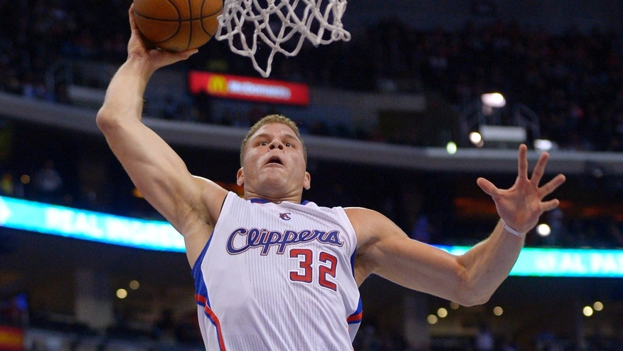 Los Angeles Clippers forward Blake Griffin goes up for a dunk during the first half of an NBA basketball game against the Washington Wizards, Wednesday, Jan. 29, 2014, in Los Angeles. (AP Photo/Mark J. Terrill)