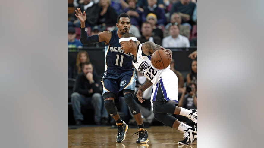 Memphis Grizzlies guard Mike Conely, left, defends against Sacramento Kings guard Isaiah Thomas during the first quarter of an NBA basketball game in Sacramento, Calif., Wednesday, Jan. 29, 2014.(AP Photo/Rich Pedroncelli)