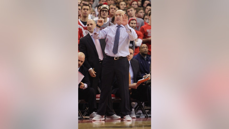 Penn State head coach Patrick Chambers signals to his team as they play Ohio State during the second half of an NCAA college basketball game Wednesday, Jan. 29, 2014, in Columbus, Ohio. Penn State beat Ohio State 71-70 in overtime. (AP Photo/Jay LaPrete)