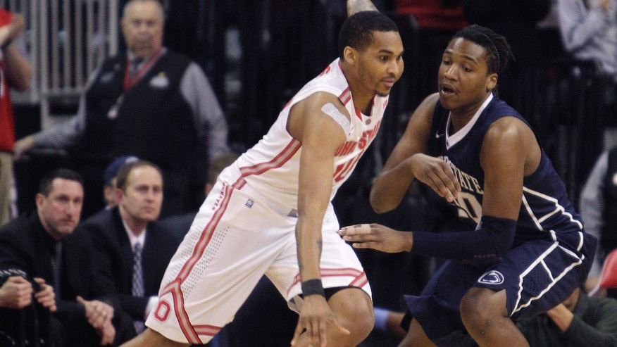 Ohio State's LaQuinton Ross, left, drives to the basket against Penn State's Brandon Taylor during the first half of an NCAA college basketball game Wednesday, Jan. 29, 2014, in Columbus, Ohio. (AP Photo/Jay LaPrete)