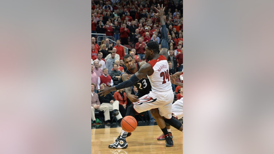Cincinnati's Sean Kilpatrick passes around Louisville's Montrezl Harrell during the second half of an NCAA college basketball game Thursday, Jan. 30, 2014, in Louisville, Ky. Cincinnati defeated Louisville 69-66. (AP Photo/Timothy D. Easley)