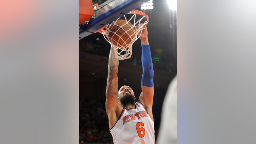 New York Knicks' Tyson Chandler dunks the ball during the second quarter of an NBA basketball game against the Cleveland Cavaliers Thursday, Jan. 30, 2014, at Madison Square Garden in New York. (AP Photo/Bill Kostroun)