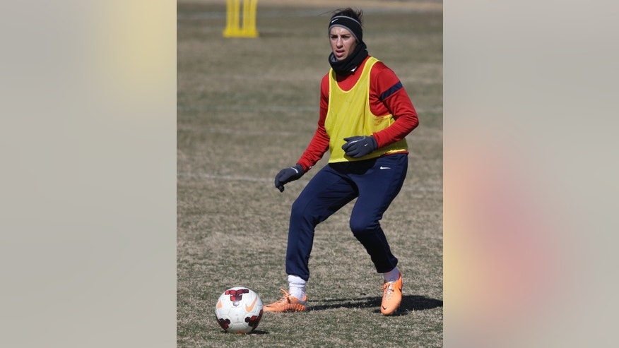 In this photo made Tuesday, Jan. 28, 2014, U.S. women's soccer team player Carli Lloyd passes the ball  during practice in Frisco, Texas. The U.S. women's soccer team opens its season against Canada in Texas on Friday, Jan. 31, their second meeting since the 2012 Olympic match. (AP Photo)