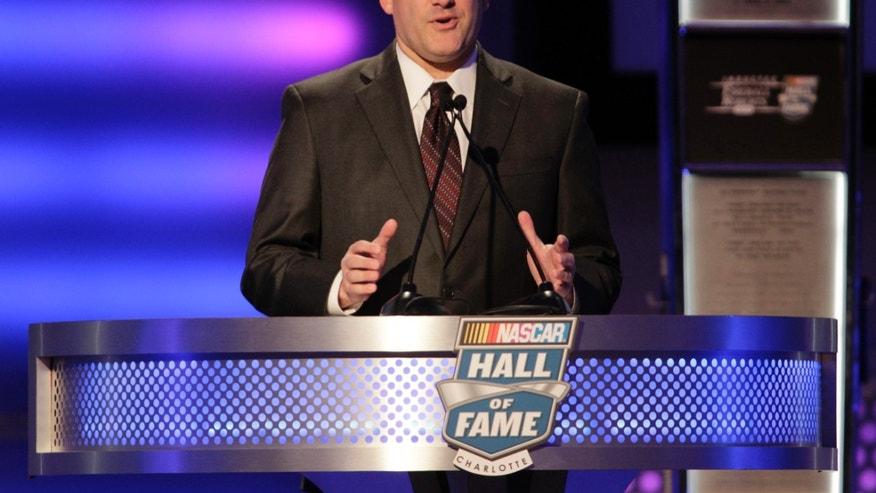 Tony Stewart talks about his relationship with former driver Dale Jarrett during the NASCAR Hall of Fame induction ceremony, Wednesday, Jan. 29, 2014, in Charlotte, N.C. (AP Photo/Bob Leverone)