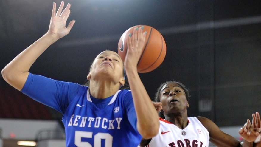 Kentucky forward/center Azia Bishop (50) and Georgia guard/forward Krista Donald (15) try to control a rebound during the first half of an NCAA college basketball game on Thursday, Jan. 30, 2014, in Athens, Ga. (AP Photo/AJ Reynolds)