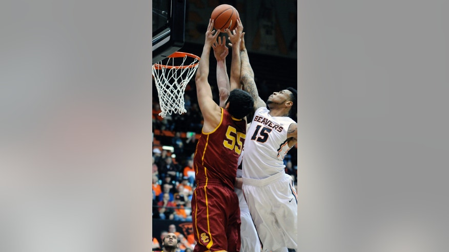 Southern California's Omar Oraby (55) shoots against Oregon State's Eric Moreland (15) during the first half of an NCAA college basketball game in Corvallis, Ore., Thursday Jan. 30, 2014.  (AP Photo/Greg Wahl-Stephens)
