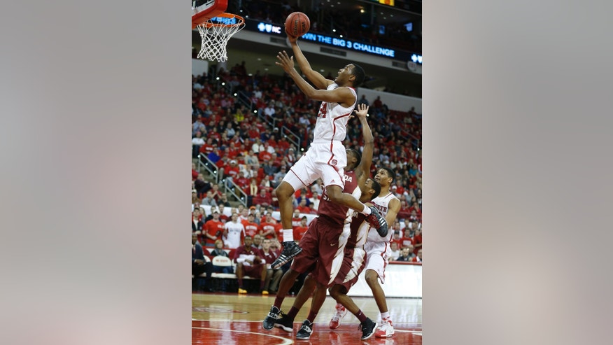 N.C. State's T.J. Warren (24) drives to the basket during the first half of an NCAA basketball game, Wednesday, Jan. 29, 2014 in Raleigh, N.C. (AP Photo/The News & Observer, Ethan Hyman) MANDATORY CREDIT: ETHAN HYMAN, THE NEWS & OBSERVER