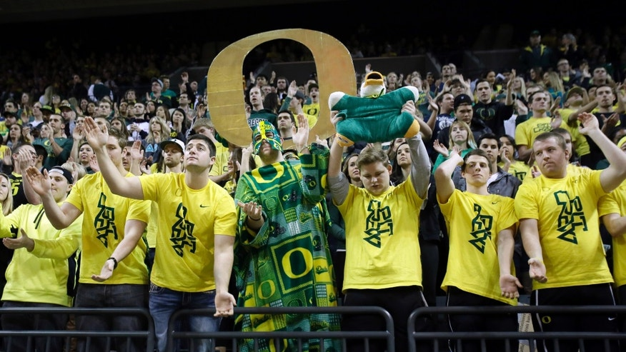 Oregon fans cheer as their team is introduced during an NCAA college basketball against UCLA game in Eugene, Ore., Thursday, Jan. 30, 2014. (AP Photo)