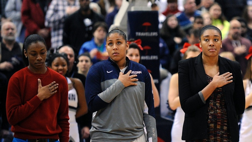 Connecticut's Brianna Banks, Kaleena Mosqueda-Lewis and Morgan Tuck, left to right, listen to the National Anthem before their NCAA college basketball game against South Florida in Hartford, Conn., Sunday, Jan. 26, 2014. (AP Photo/Fred Beckham)