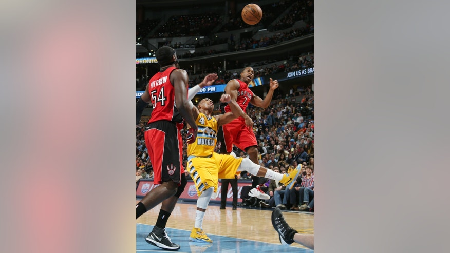 Toronto Raptors guard Kyle Lowry, right, deflects a shot by Denver Nuggets guard Randy Foye, center, as Raptors forward Patrick Patterson looks on in the third quarter of  an NBA basketball game in Denver, Friday, Jan. 31, 2014. (AP Photo/David Zalubowski)