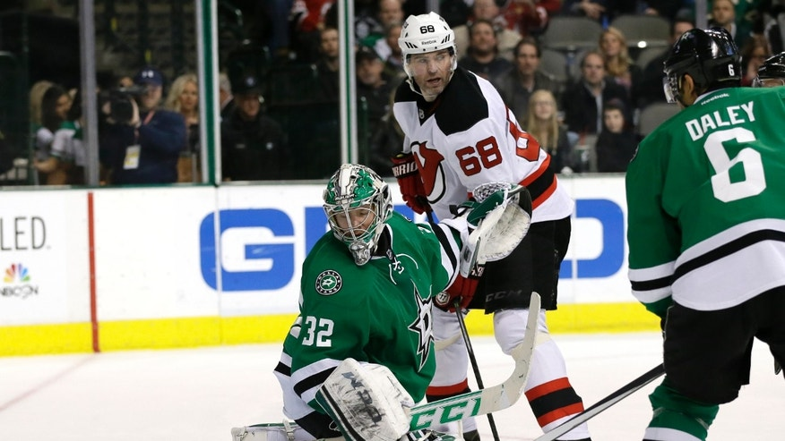 Dallas Stars' Kari Lehtonen (32) of Finland, Stars' Trevor Daley (6) and New Jersey Devils' Jaromir Jagr (68), of the Czech Republic, watch as a shot by Devils' Travis Zajac gets by Lehtonen for a goal in the second period of an NHL hockey game on Thursday, Jan. 30, 2014, in Dallas. (AP Photo/Tony Gutierrez)