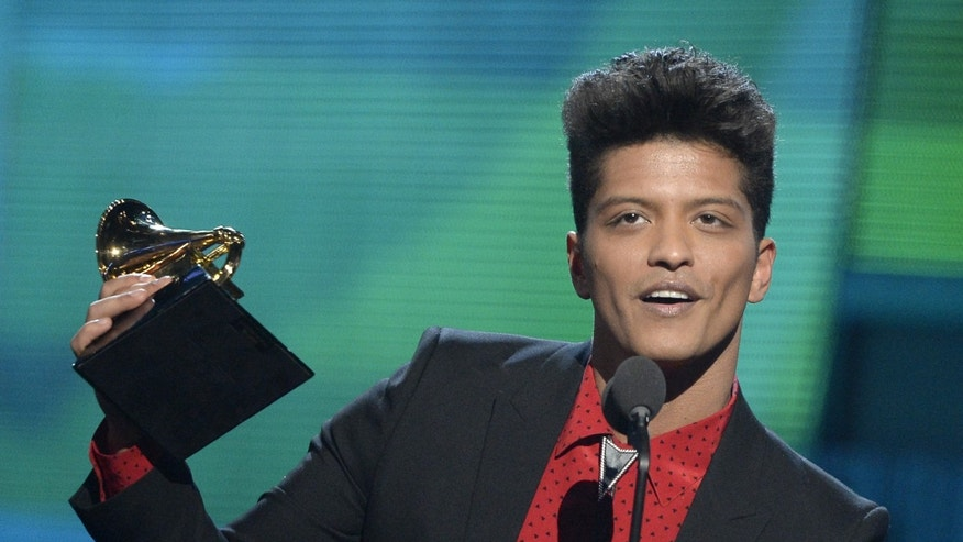 LOS ANGELES, CA - JANUARY 26:  Musician Bruno Mars accepts the Best Pop Vocal Album award for 'Unorthodox Jukebox' onstage during the 56th GRAMMY Awards at Staples Center on January 26, 2014 in Los Angeles, California.  (Photo by Kevork Djansezian/Getty Images)