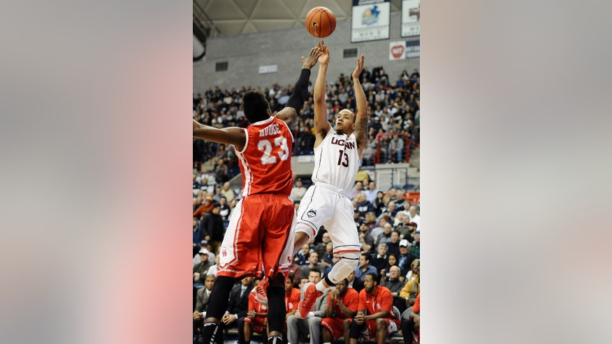 Connecticut's Shabazz Napier shoots over Houston's Danuel House during the first half of an NCAA college basketball game, Thursday, Jan. 30, 2014, in Storrs, Conn. (AP Photo/Jessica Hill)