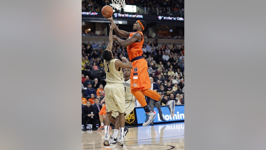 Syracuse's C.J. Fair, right, shoots over Wake Forest's Madison Jones, left, during the second half of an NCAA college basketball game in Winston-Salem, N.C., Wednesday, Jan. 29, 2014. Syracuse won 67-57. (AP Photo/Chuck Burton)