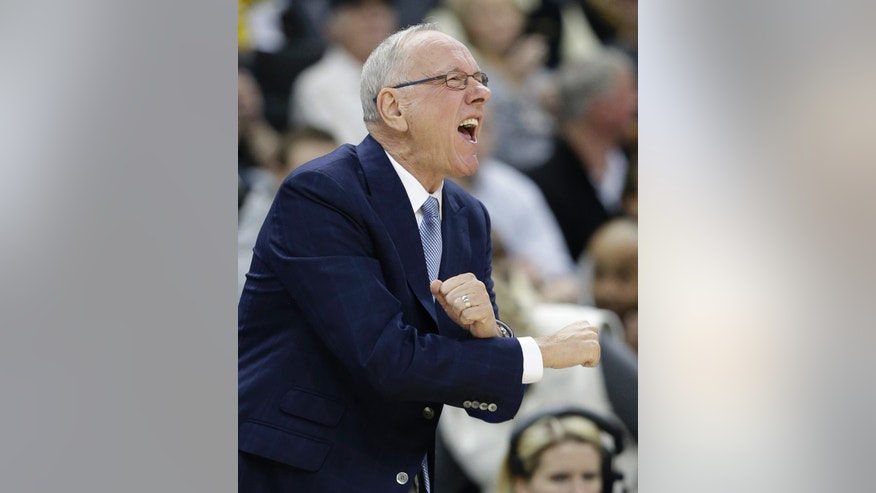 Syracuse head coach Jim Boeheim directs his team against Wake Forest during the first half of an NCAA college basketball game in Winston-Salem, N.C., Wednesday, Jan. 29, 2014. (AP Photo/Chuck Burton)
