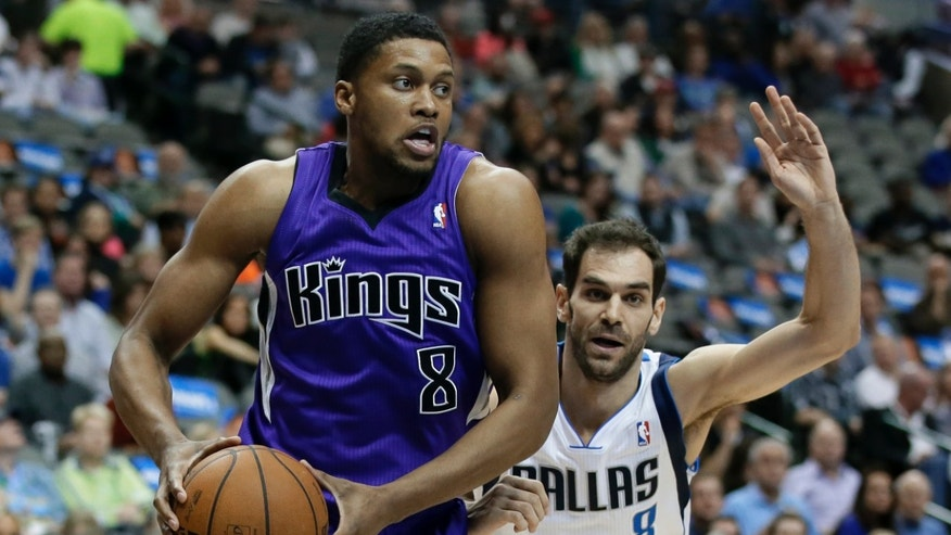 Sacramento Kings' Rudy Gay (8) drives past Dallas Mavericks' Jose Calderon (8) in the first half of an NBA basketball game, Friday, Jan. 31, 2014, in Dallas. (AP Photo/Tony Gutierrez)