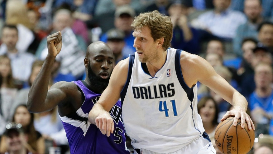 Dallas Mavericks' Dirk Nowitzki (41) positions against Sacramento Kings' Quincy Acy for an opening to the basket in the first half of an NBA basketball game, Friday, Jan. 31, 2014, in Dallas. (AP Photo/Tony Gutierrez)