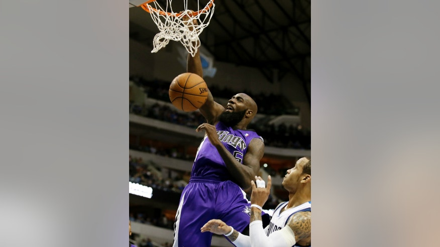Sacramento Kings forward Quincy Acy (5) dunks over Dallas Mavericks' Monta Ellis, right, in the first half of an NBA basketball game, Friday, Jan. 31, 2014, in Dallas. (AP Photo/Tony Gutierrez)