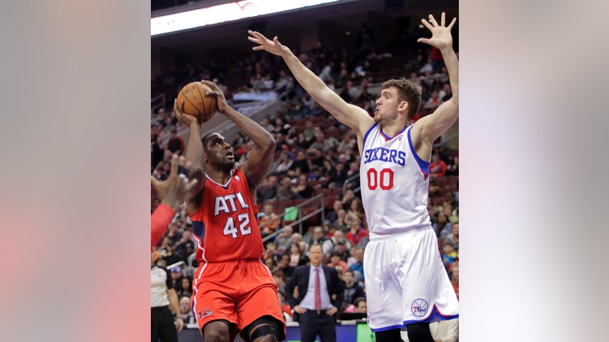 Atlanta Hawks' Elton Brand (42) looks to shoot as Philadelphia 76ers' Spencer Hawes (00) defends in the first half of an NBA basketball game, Friday, Jan. 31, 2014 in Philadelphia. (AP Photo/H. Rumph Jr.)