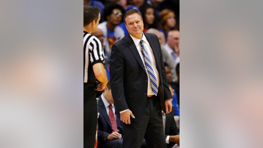 Kansas head coach Bill Self smiles at a game official during the second half of an NCAA college basketball game against Iowa State in Lawrence, Kan., Wednesday, Jan. 29, 2014. Kansas won 92-81. (AP Photo/Orlin Wagner)
