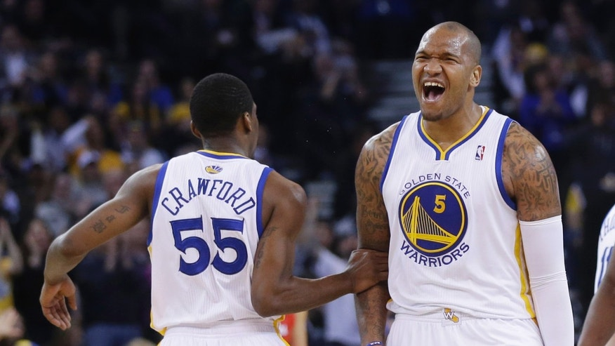 Golden State Warriors' Marreese Speights (5) celebrates after teammate Jordan Crawford (55) made a 3-point basket against the Los Angeles Clippers during the first half of an NBA basketball game Thursday, Jan. 30, 2014, in Oakland, Calif. (AP Photo)